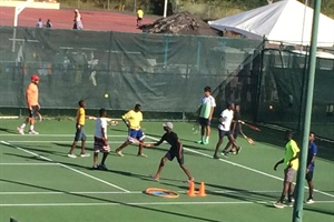 Hurricane Refugees Enjoy Tennis Clinic